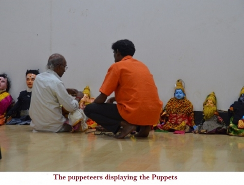 Puppeteers displaying various puppets