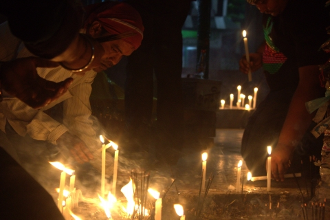 Lighting of candles and incense sticks by the devotees at Pagla Baba Mazar.