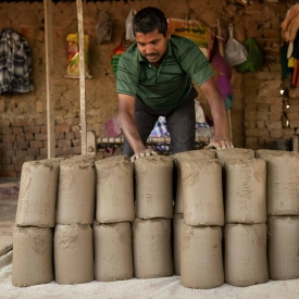 The pug mill produces compact clay which are cut off in the shape of Shivling and stacked. These moulds are thrown on the chaak to give shape to pottery items (Courtesy: Jai Thakur)