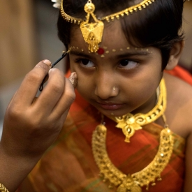 During Durga Puja, Adi Shakti is worshipped in the form of a prepubescent young girl who is assigned temporary sacredness as the earthly manifestation of Devi Durga. This special ritual—Kumari Puja—is practised by several bonedi baris in Kolkata.
