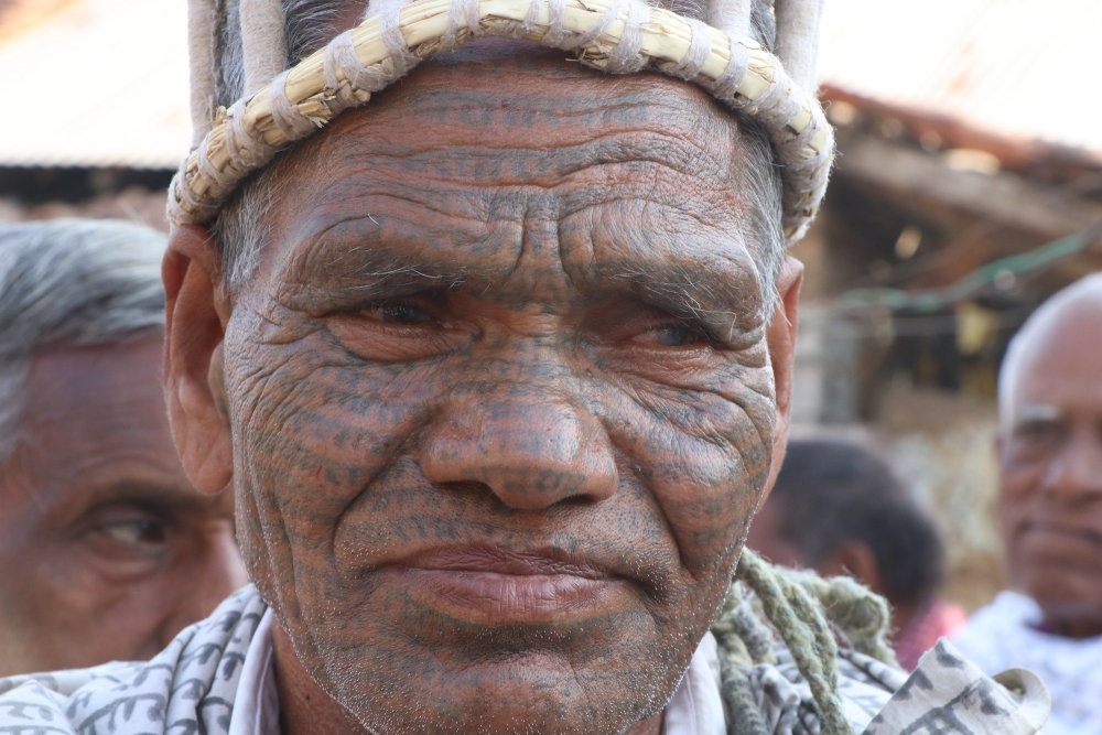 A ramnami man with ram-ram godna on his face