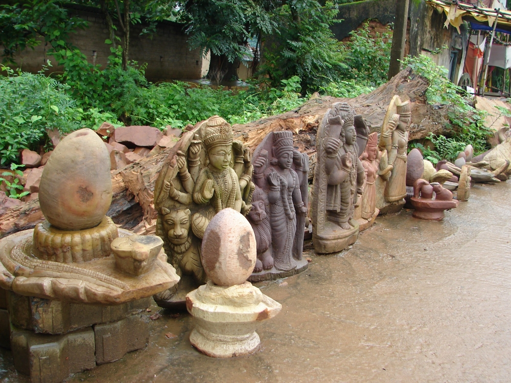 A row of finished stone sculptures