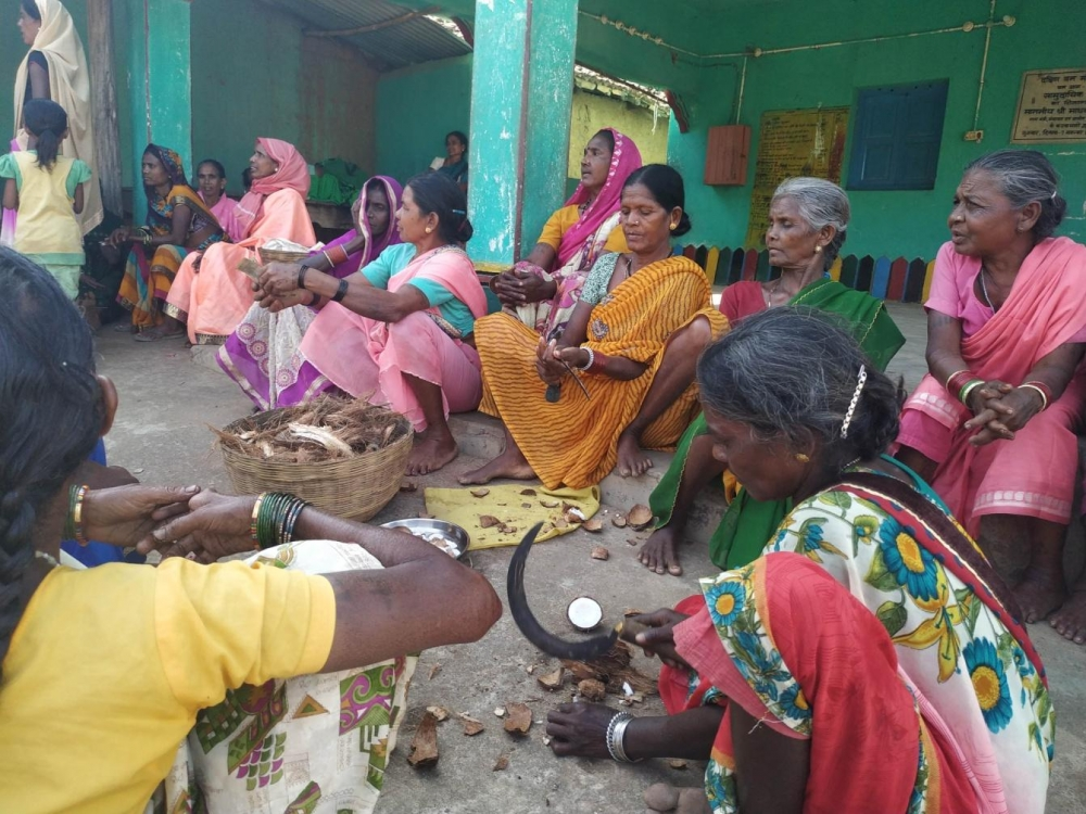 Women bought coconut from the money they collected and distributed it among themselves as the part of a collective effort to earn so much offerings.