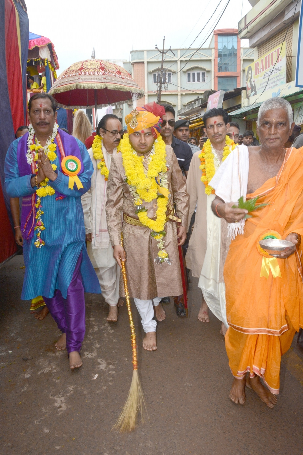 The king inaugurates the rath yatra by brooming the street, making way for the rath