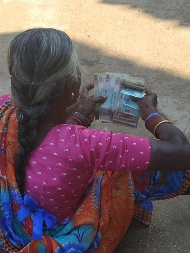 Woman with her share of money.