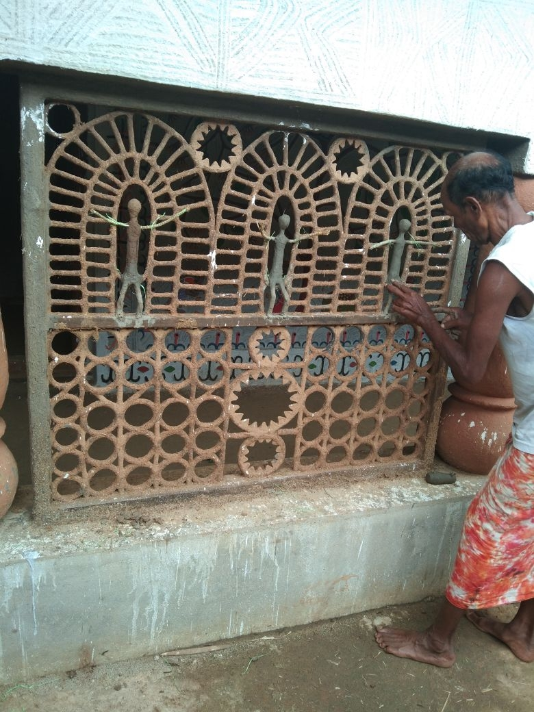 Pandit Ram working on a designer separator inside the house