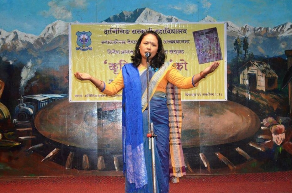 Fig. 1: Pavitra Lama performing her poem 'Asaari' at the vimochan samaroh (inauguration ceremony) of the Indian Nepali author, Binesh Pradhan's Kriti Adhiti, a collection of critical essays, held at Darjeeling Government College, Darjeeling, West Bengal on October 22, 2016 (Courtesy: Sherap Bhutia)
