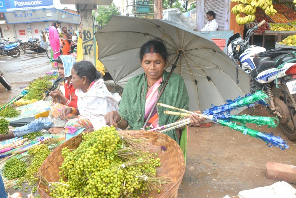 A woman selling tubki at the Goncha fair