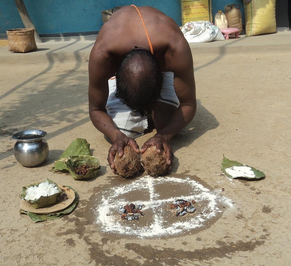 Offering Mahua to village deity