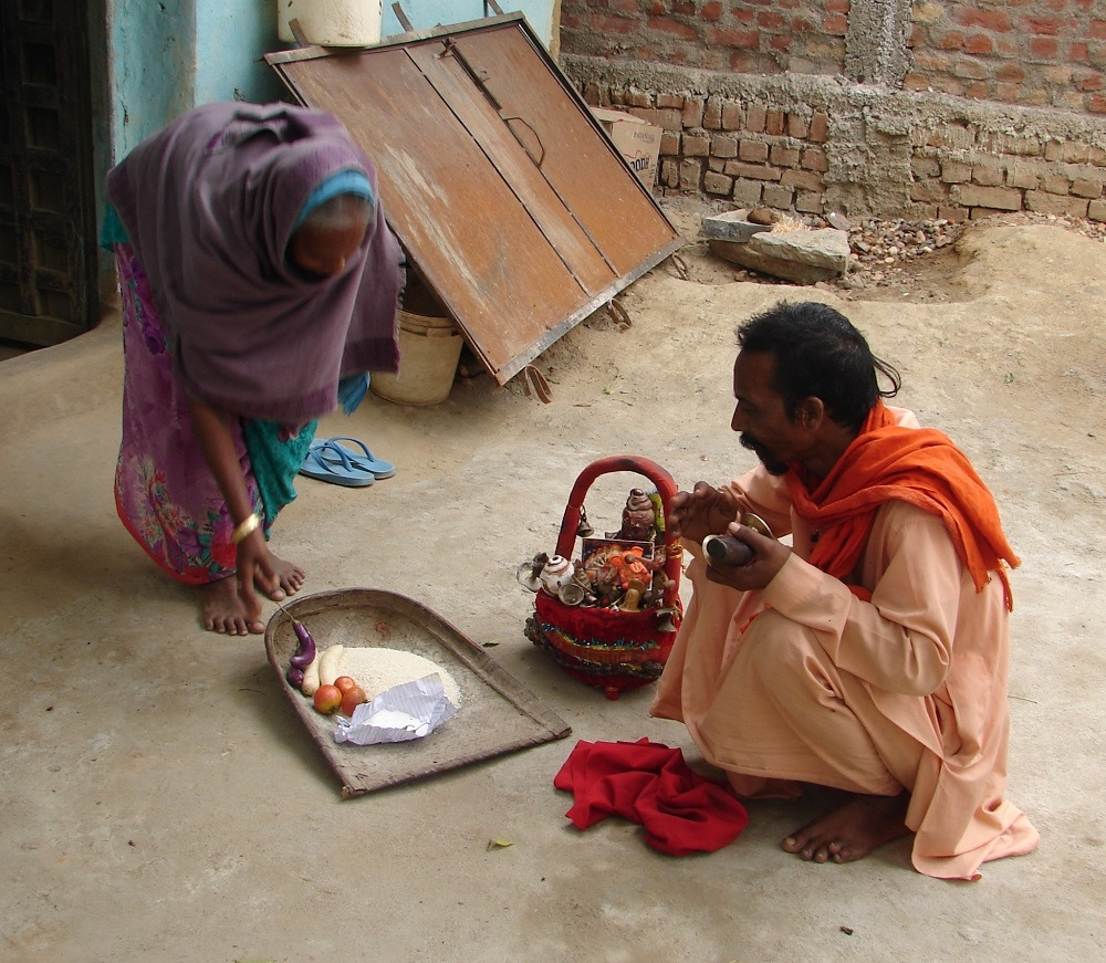 Ram Prasad Vasudeva receiving offering from a woman