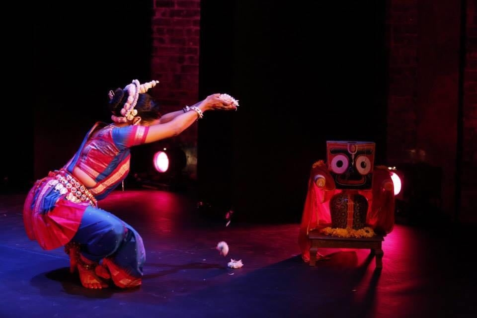 Fig. 3. Sonali Mishra offers flowers (pushpanjali) to a figure of Jagannath while performing the mangalacharan, 'bhaje brajekamandanam', choreographed by Bichitrananda Swain, during a performance in New York City, USA, in 2013 (Photograph by J'adore Andy Photography; Courtesy: Navatman).