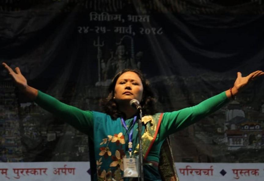 Fig. 6:Pavitra Lama performing her poem, 'Harkamaya' at the International Nepali Women's Literary Meet, Tadong, Gangtok, Sikkim on April 6, 2018 (Courtesy: Nimesh Subba)