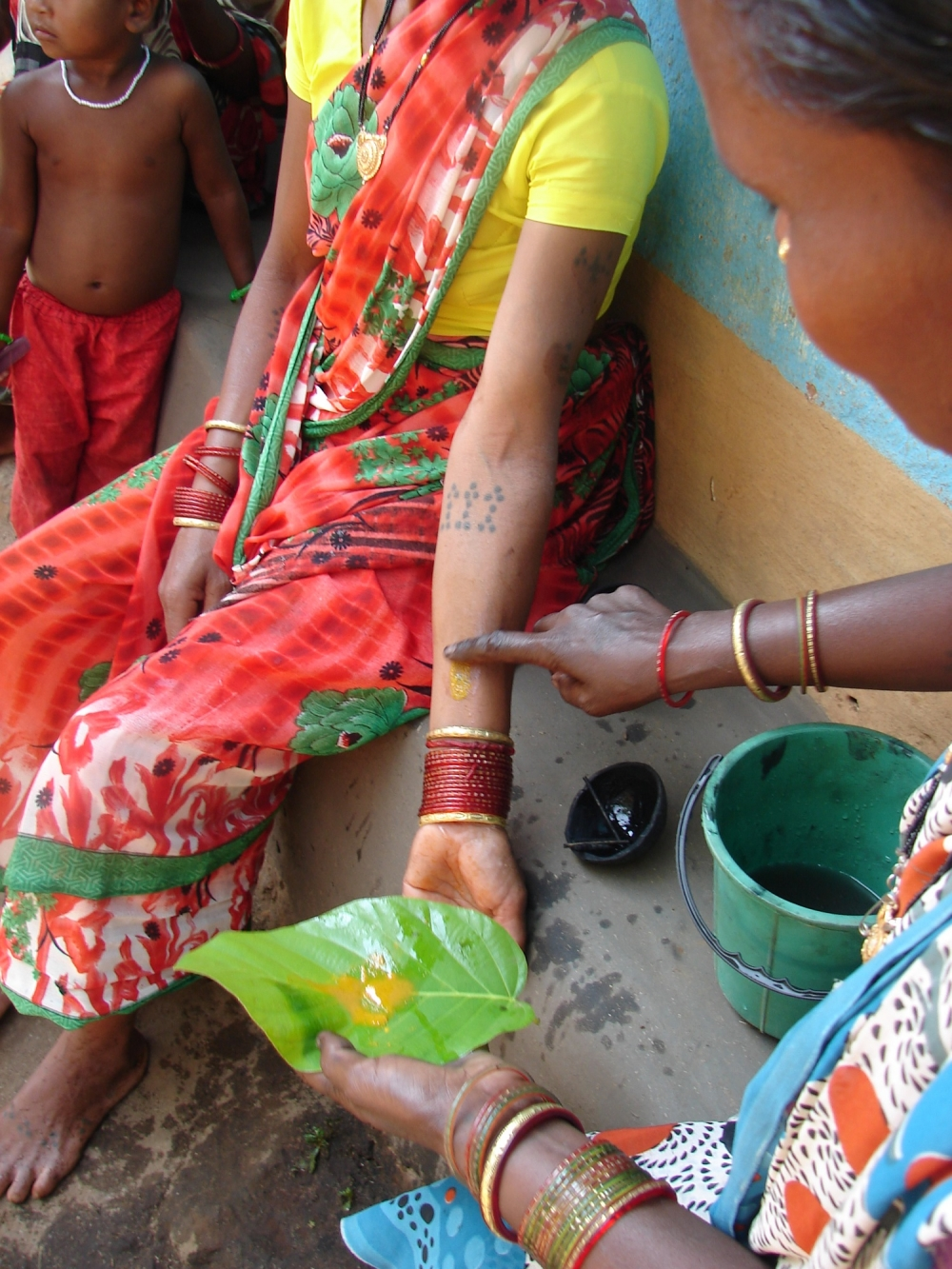 Turmeric paste is applied to the newly etched godna