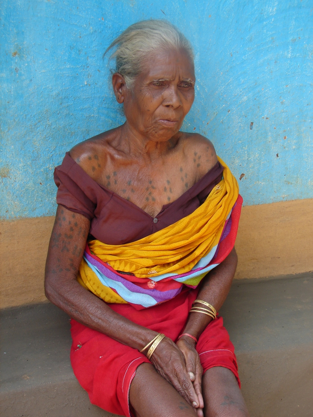 A woman with godna on her chest and hands