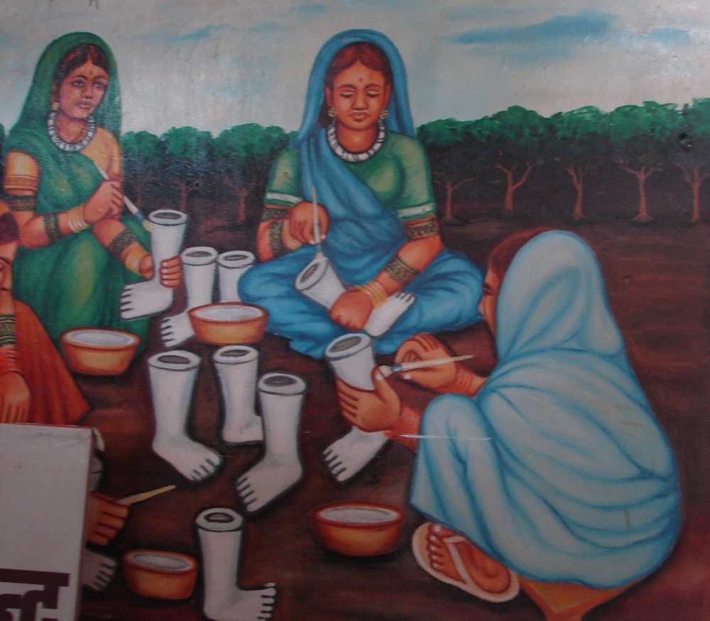 A poster of women involved in clay work
