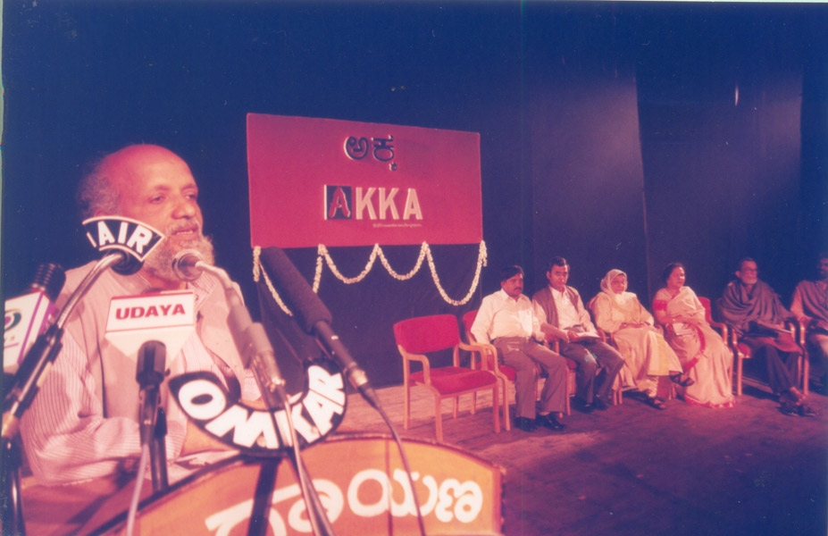 Fig. 8. The then director Prasanna speaking during the inauguration of the Akka theatre festival, the seed of the annual Bahuroopi festival. Sitting on the dais is also Rangayana's founder BV Karanth (Courtesy: Rangayana)