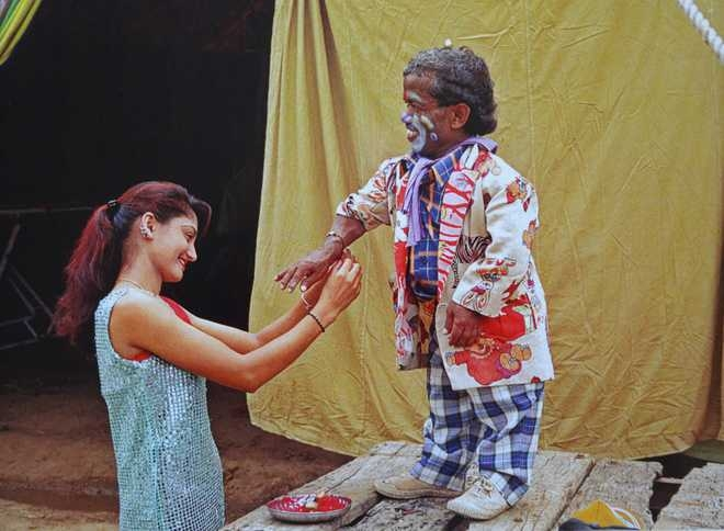 A woman tying a rakhi-thread to a clown. This photograph is part of Vivek Desai's work called 'Circus and Me' (Courtesy: The Tribune)