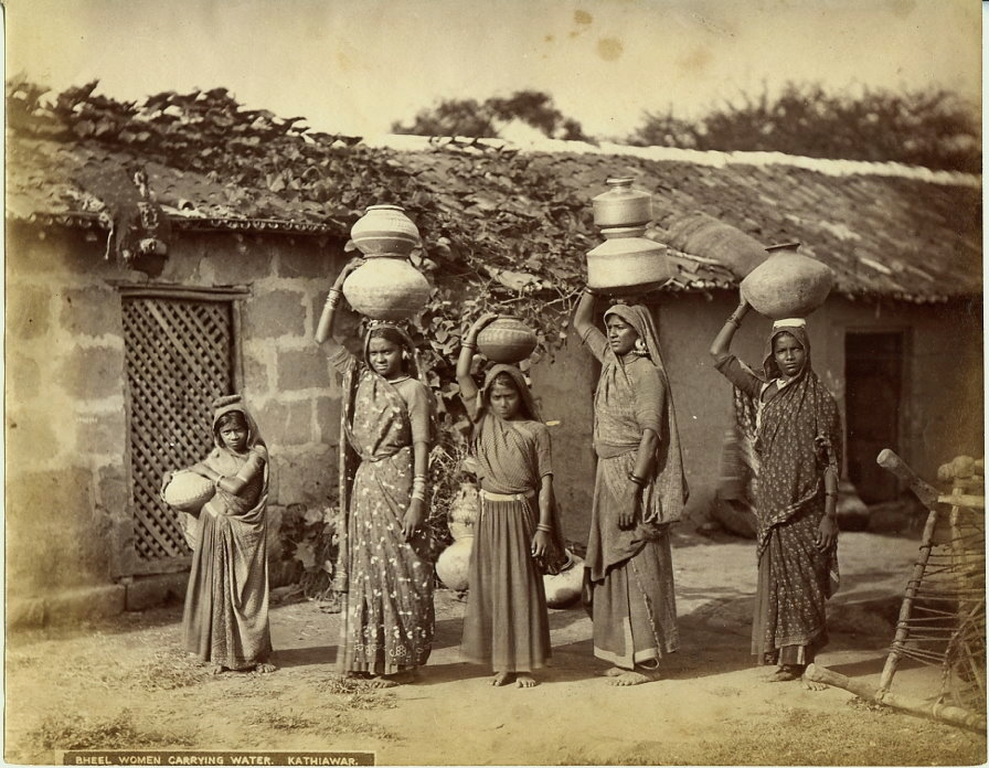 Bhil women Carrying water on their head - Kathiawar in the 1880s_Wikimedia Commons