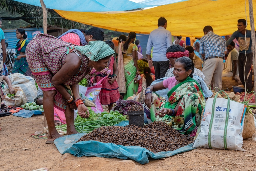 a Woman Selling Mahua in the local Market