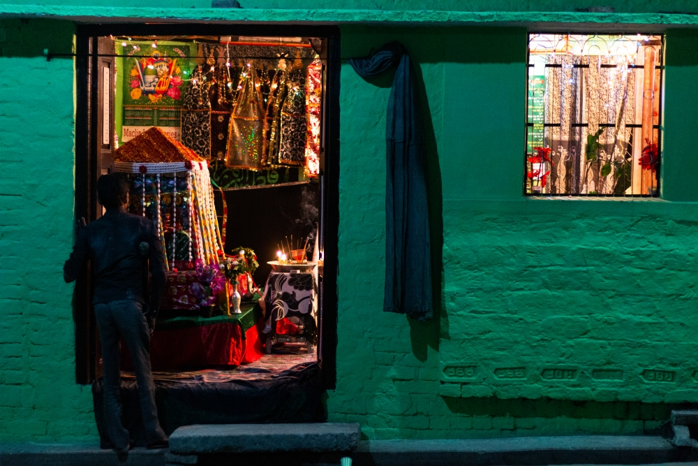 Fig. 6: A man stands outside an azakhana in Jais, Amethi on the evening of ashoora. Azakhana remains open for people to pay their respects and perform matam and majalis until the tenth day of Muharram