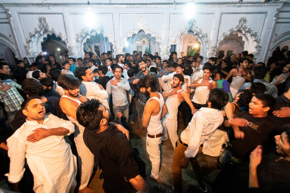 Fig. 3: Men performing matam inside an imambada in Amroha a night before Chehlum