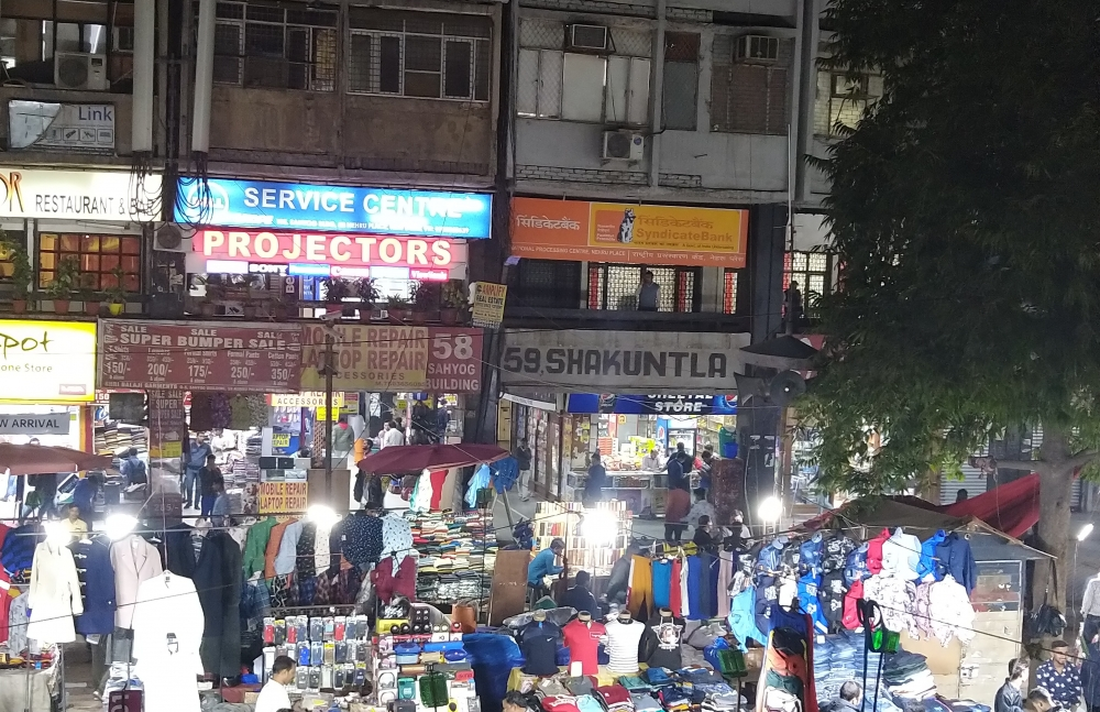 Fig. 10. Digitally printed signboards are replacing the hand-painted signage. The image of Nehru Place shows the predominance of digital signages amidst which the old hand-painted sign announcing '58 SHAKUNTALA' stands as an exception