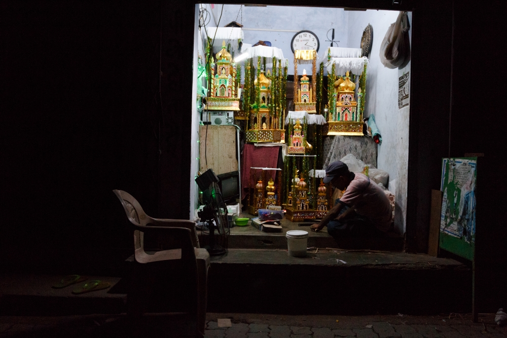 Fig. 3: A taziya maker working late at night inside his roadside shop in Lucknow's Kashmiri Mohalla