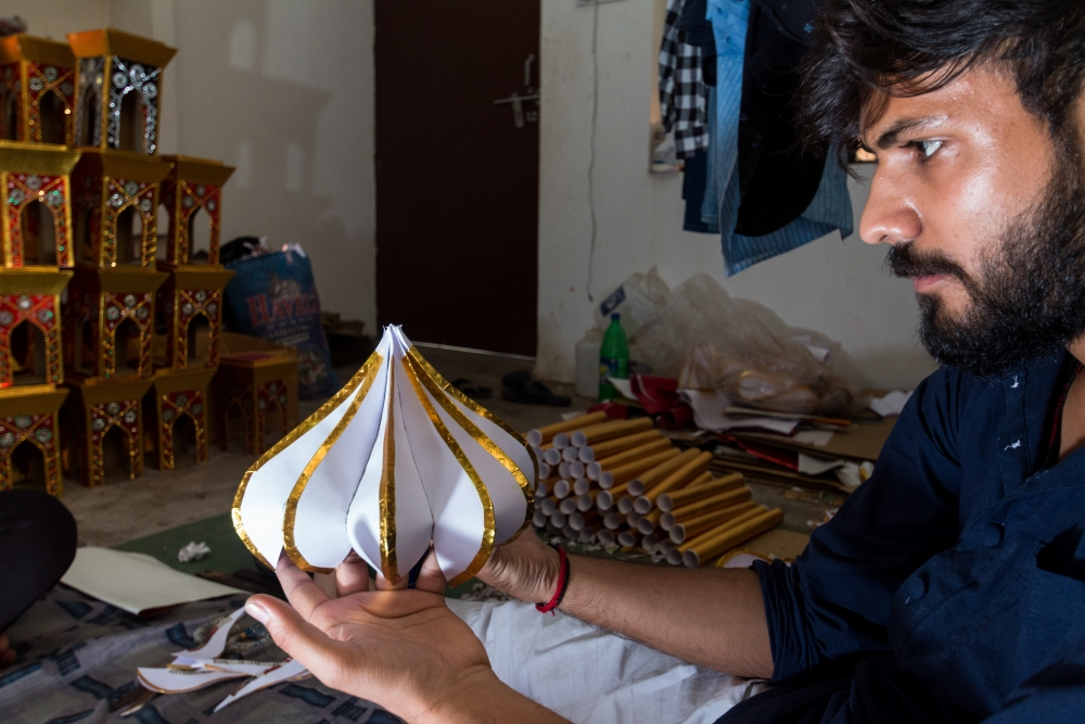Fig. 4: A taziya maker looks at a finished kamrakhi gumzi. The kamrakhi gumzi was introduced by Sikander Mirza about half a century ago