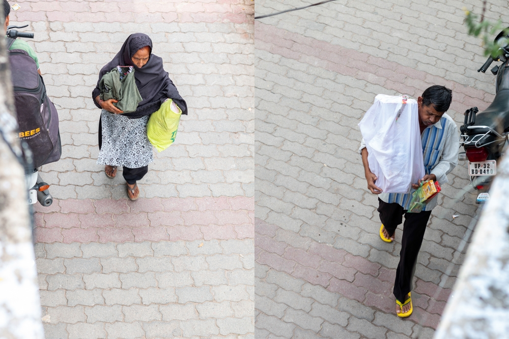 Fig. 6: A woman and a man seen carrying their taziya wrapped in a cloth after buying it from a market in Kashmiri Mohalla, Lucknow.
