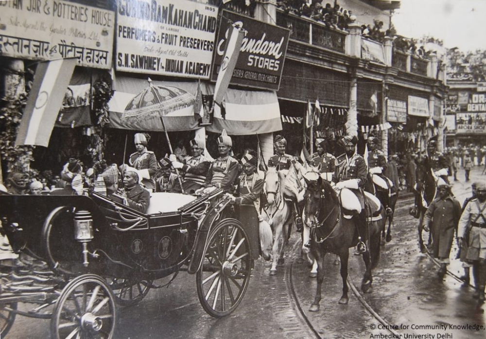 Fig 1: Dr. Rajendra Prasad in the presidential coach, Chandni Chowk, 1950. While the image focuses on the parade, it simultaneously documents the shop signages on the street (Courtesy:Narain Prasad, from the CCK Archives, Ambedkar University Delhi)