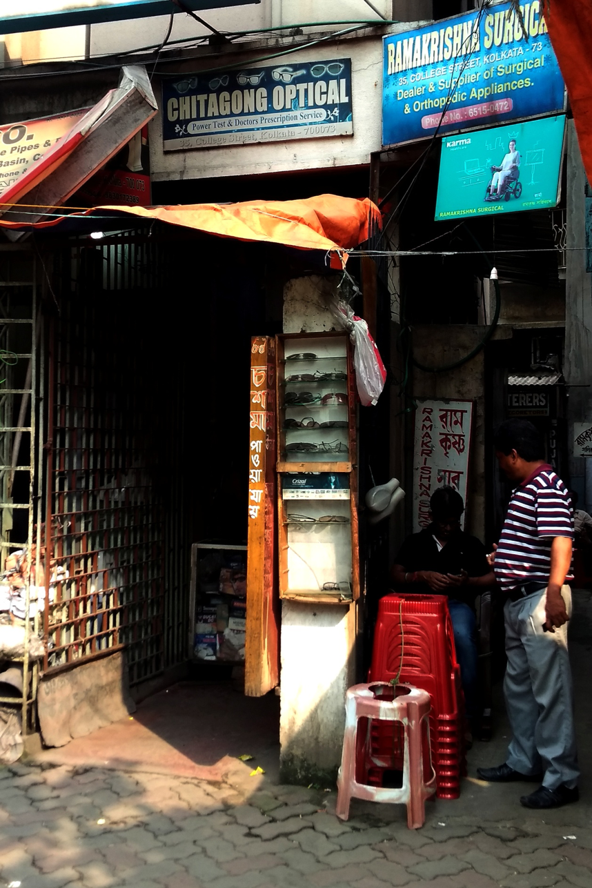 Fig. 1: College Street: Chittagong Optical. The owner says the shop was established by his father 70 years ago. Courtesy: Priyankar Dey