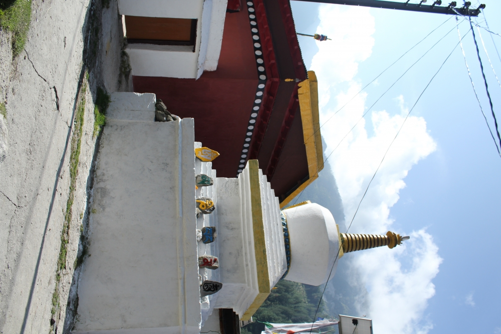 Fig 2: The Buddhist Stupa with Mani stones and the temple in the background. Every morning people in the village circumambulate around the temple and the stupa
