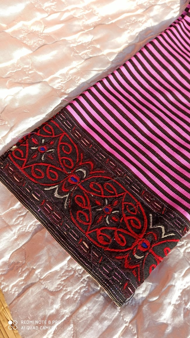 Fig. 3: The bordered embroidery dominated by black and red colours represents the traditional khoi akoibi. It has been an adapted from the older khoi mayek