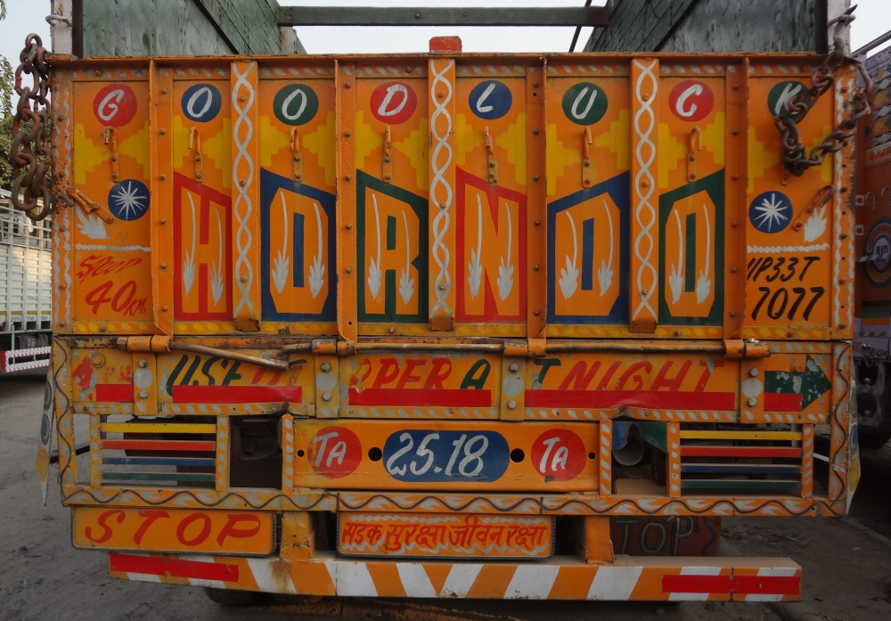 Fig. 3: A truck parked at Sanjay Gandhi Transport Nagar. Truck literature often shows concern about road safety, as seen in this picture, which asks for a horn to be honked and a dipper used at night to ensure safety