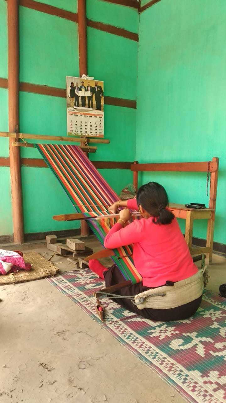Fig 4: The khwang loom has traditionally been used to make all phanek mayek naibi as well as other shawls. Two halves of the phanek are woven with silk or cotton borders on the top and bottom and stitched together in the middle