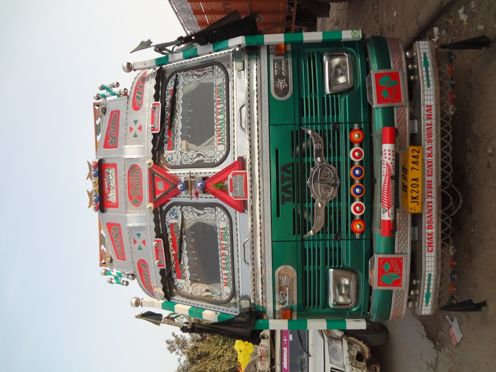 Fig. 4: Trucks registered in Jammu and Kashmir are distinctly visible owing to their bright colours and slanted cab roofs. This is a J&K truck parked in Sanjay Gandhi Transport Nagar