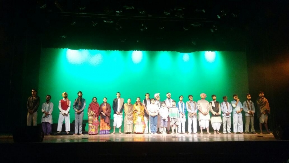Fig 4: Veteran theatre director Ranjit Kapoor held a fortnight-long theatre workshop in Agra with the young artistes of the Ranglok group and staged a dramatic adaptation of Phanishwarnath Renu's story 'Panchlight' in the Soorsadan auditorium on August 19, 2018. The play satirises rural politics and beliefs with a tongue-in-cheek humour.