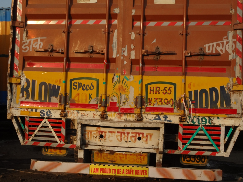 Fig. 4: Truck drivers take pride in following road safety regulations. Messages for safe driving on the back of trucks are a common occurrence. The message on this truck reads 'I am proud to be a safe driver'.