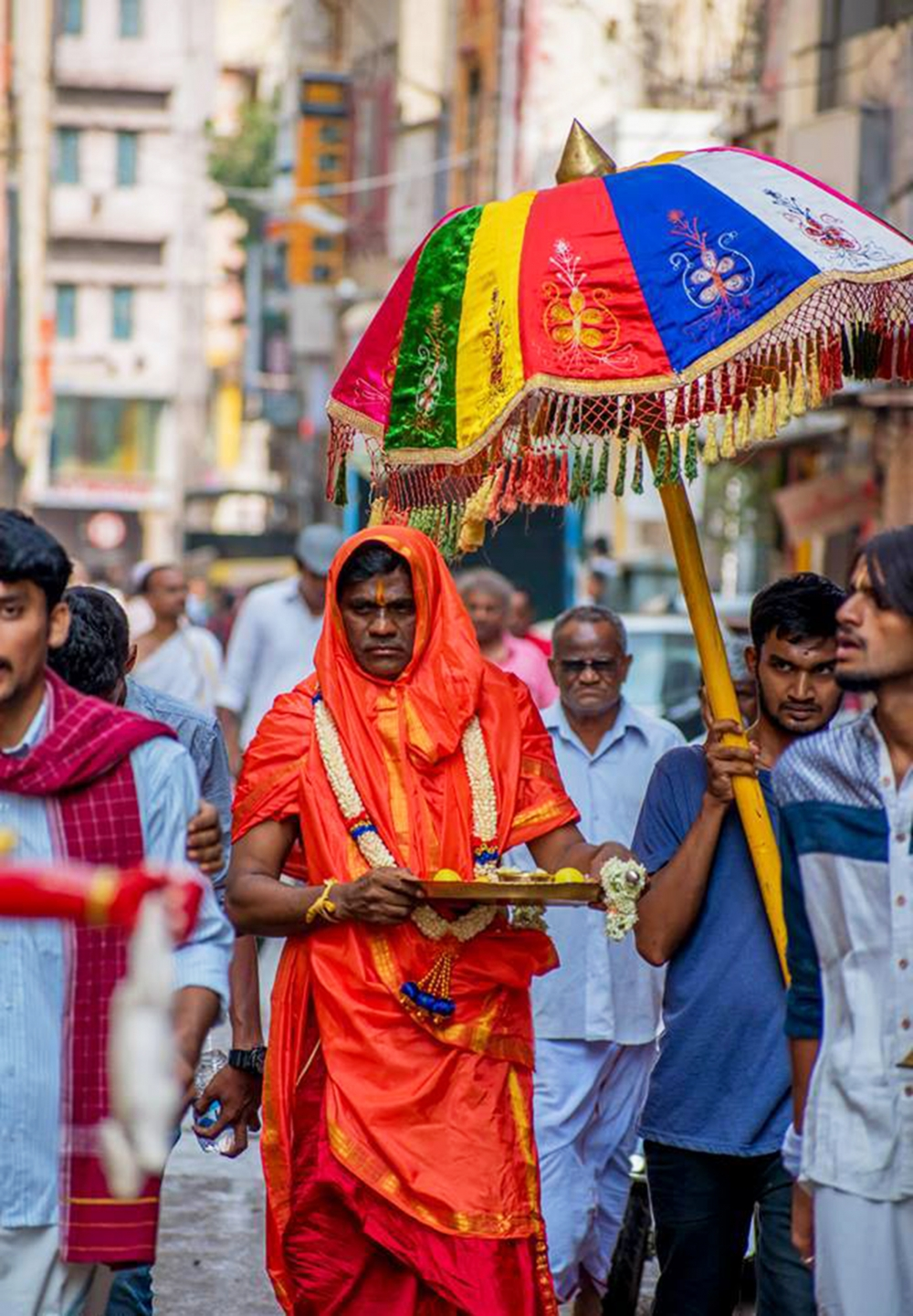 Fig. 4. One of the secondary priests on his way to a temple in Majestic to perform Gange puje (Photo courtesy: Prashanth B. Vepuri, Revival Heritage Hub)