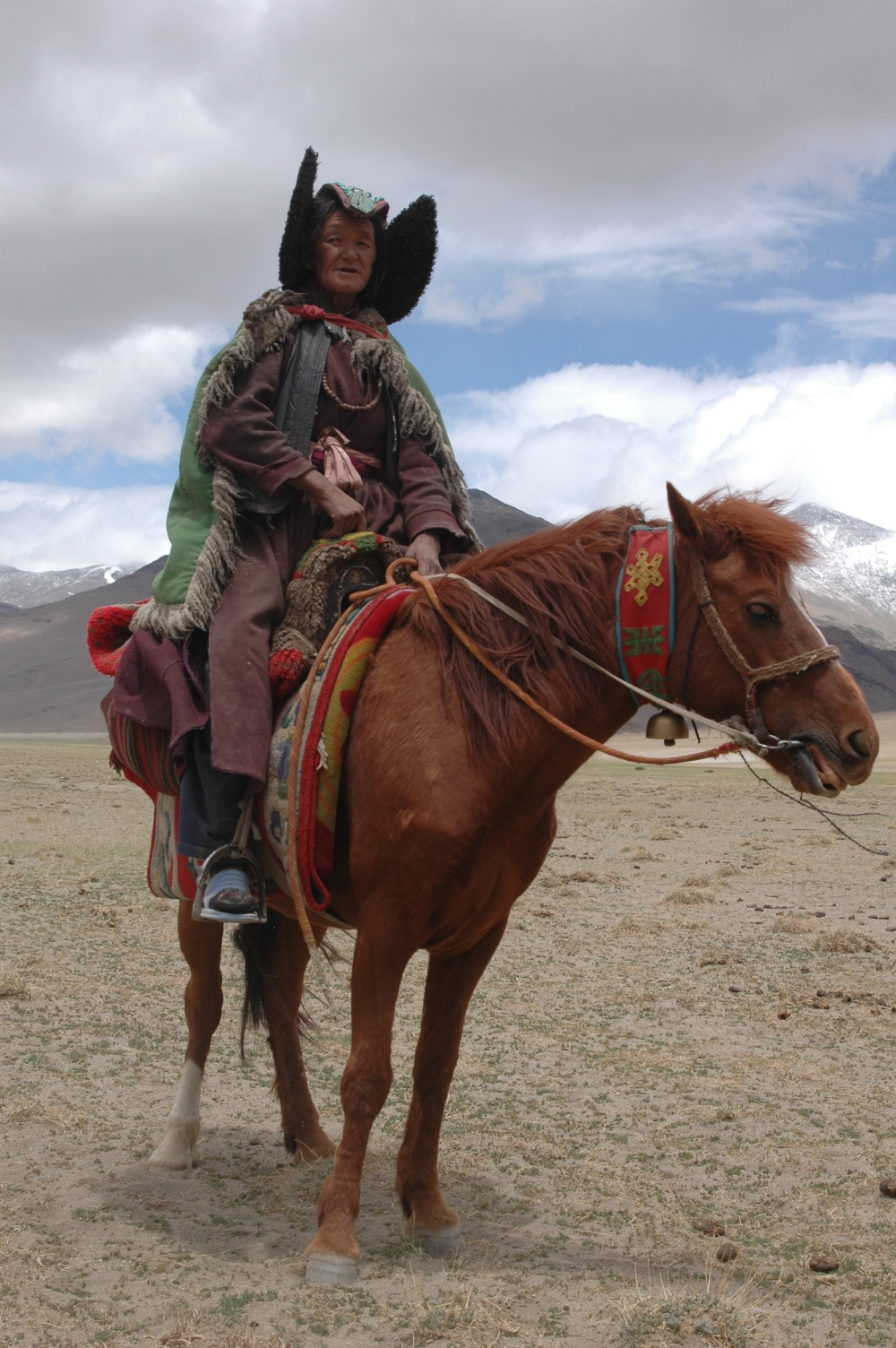 Tashi Zangmo wears her perag as she rides her horse to move from one campsite to the next, amongst the nomadic pastoralists of Changthang in eastern Ladakh.  (Photographer: Monisha Ahmed, 2006)