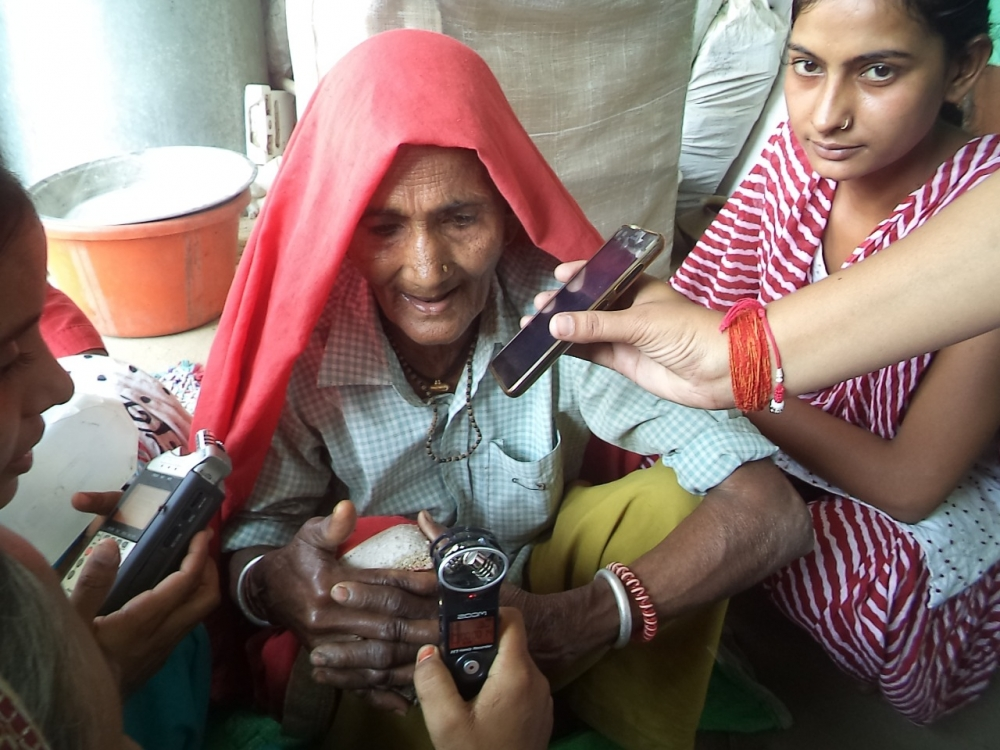 Fig. 6. Hemlata, a reporter with the radio station, Alfaz e Mewat records a community member from Bhadas, a village in the radio station's catchment area for the show, Sehat ka Paigam, discussing traditional food patterns in the region (Courtesy: Alfaz-e-Mewat)