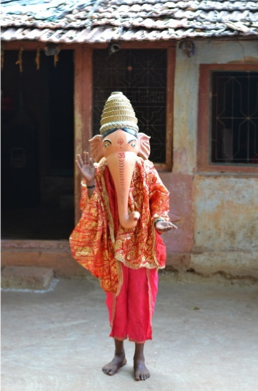 Fig. 1: A young boy dressed as Lord Ganesha for a khele performance at a wedding (Courtesy: Sonam Ambe).