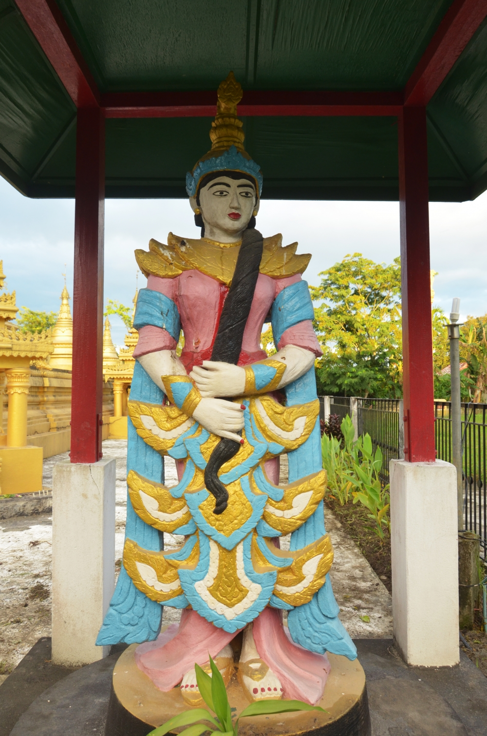 Fig. 2:A large sculpture of Vasundhara in Pariyatti Sasana Buddha Vihar, Namsai, Arunachal Pradesh. Vasundhara is the earth goddess popular among the Theravada Buddhist community of Arunachal Pradesh. According to the legend associated with her, she was the witness of the Buddha's present and previous life's deeds and is called forth to testify against the demon king, Mara, who claims Buddha's seat of meditation as his own. Vasundhara is regarded as the witness of religious donations made by devotees