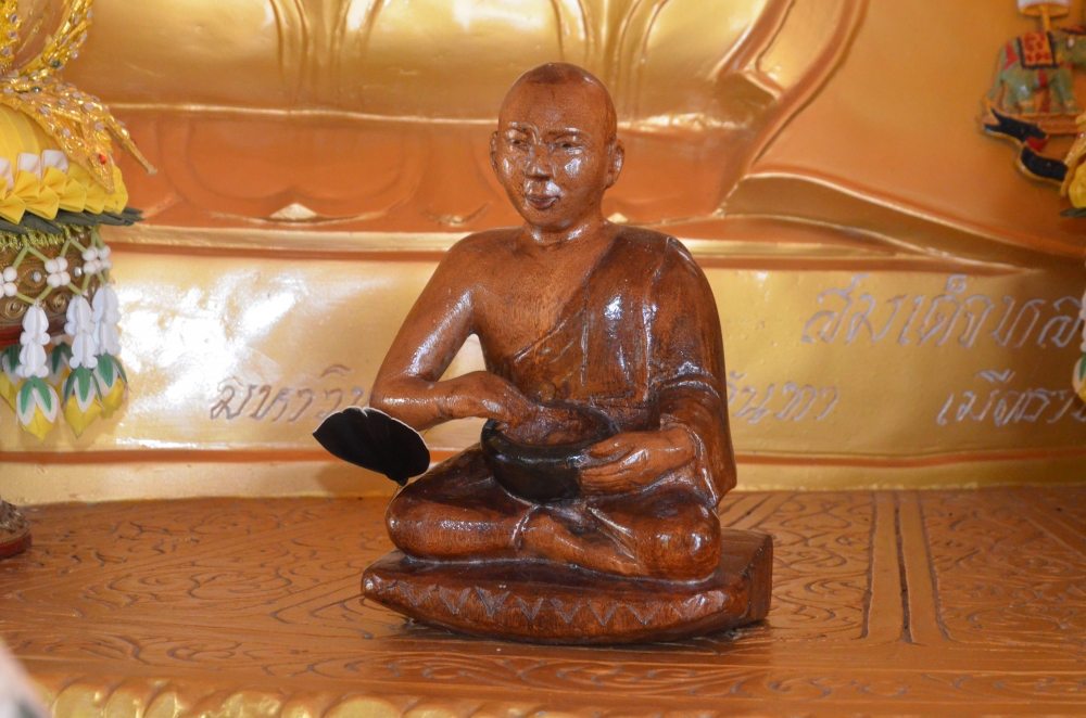 Fig. 4:A wooden image of Upagupta in Kongmu Kham (golden pagoda monastery), Tengapani, Arunachal Pradesh.In most of the Theravada monasteries of Arunachal Pradesh, small idols of Upagupta are placed near the Buddha statues. Upagupta is regarded as a powerful monk who defeated the demon, Mara. He is believed to be alive and residing in the serpent kingdom under water