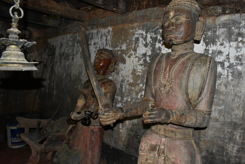 Fig 4:The daivakone at Deroddu Guttu, Nitte is uncommon because it has wooden life-size statues that are over a hundred years old. All other guttumanes have smaller, portable metal statues