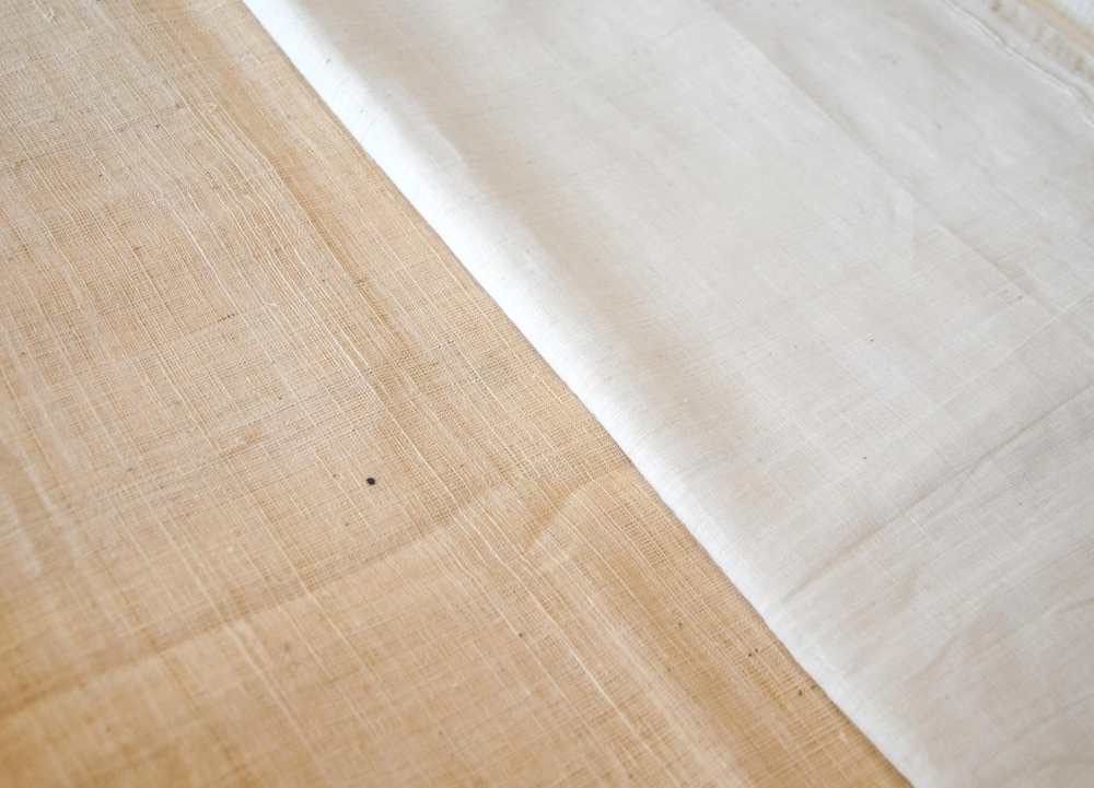Patnulu fabrics woven with yerra patti (left) and konda patti (right). Note the slight creamish tint of the yerra patti which is the natural color of the cotton. Yerra patti is used mostly for coarser varieties (Courtesy: Samyuktha Gorrepati)