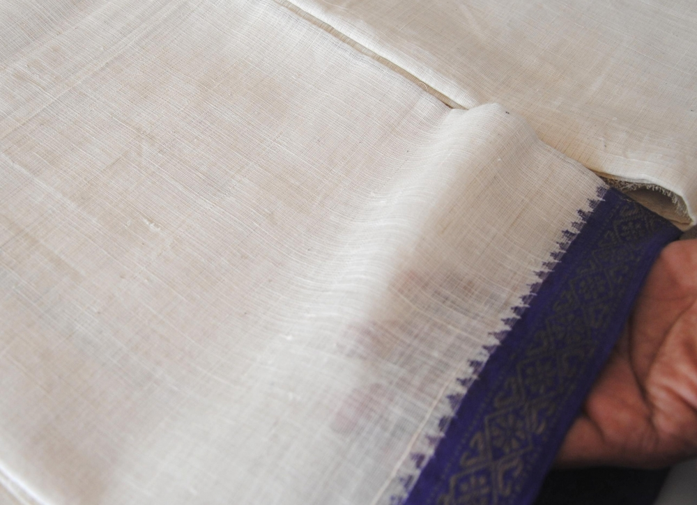 A 100s count patnulu dhoti at the khadi retail outlet with a temple border. Note the texture and fineness of the fabric (Courtesy: Samyuktha Gorrepati)