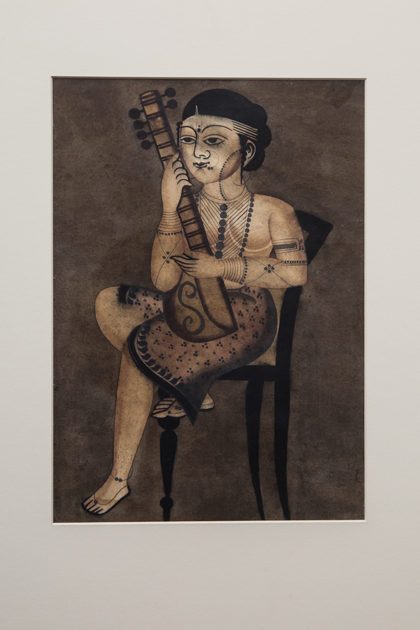 Fig 1. The Kalighat paintings were a collaborative effort by the whole family, resembling an assembly line production process. This painting shows a woman relaxing on a chair and playing the veena (Courtesy: Darshan Shah/Weavers Studio Research Centre, Kolkata)