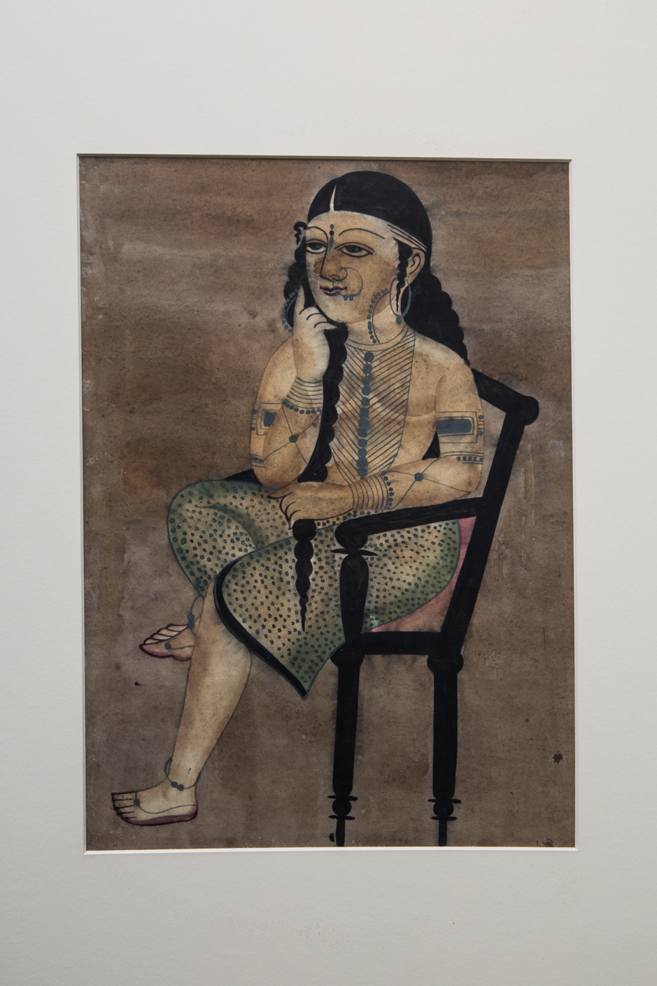 Fig 3. Kalighat paintings began to lose patronage in the early twentieth century when cheap prints filled the markets. This is a very common anonymous Kalighat painting which shows a woman sitting on a chair and thinking (Photo courtesy: Darshan Shah/Weavers Studio Research Centre, Kolkata)
