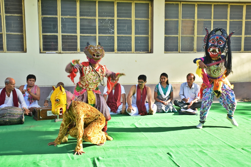 Fig. 10: Namaboli, a khon performed as a 30-minute street play with mukha (mask) dance as a part of the Dakshin Dinajpur district administration's initiative on electoral literacy ahead of the Lok Sabha elections, 2019.
